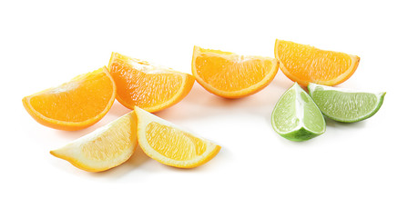 Slices of delicious citrus fruits on white background