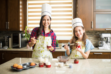 Mom and daughter with chef hats