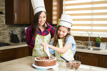 Mom teaching daughter how to bake