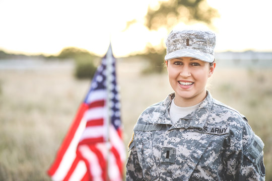 Beautiful Army Woman in Uniform with Flag