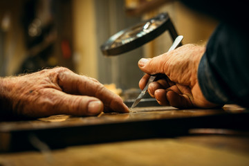 Senior wood carving professional during work Wall mural
