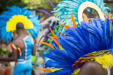 Acrylic Prints Carnaval Group of dancers wearing colorful feathers costumes gathered for a gay pride street parade