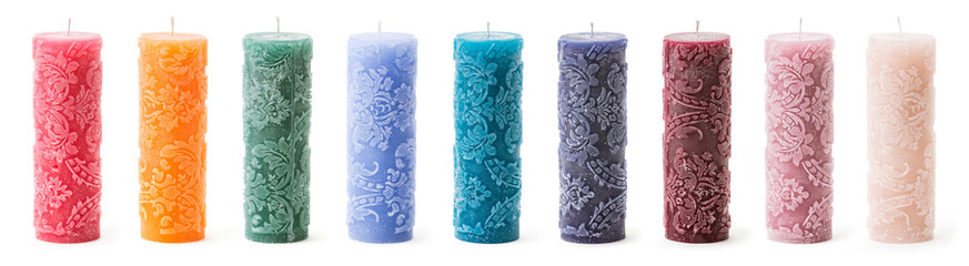 Colorful decorative candles over white