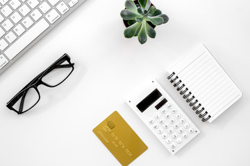 accountant or banker desk with calculator, keyboard and notebook white background top view mockup