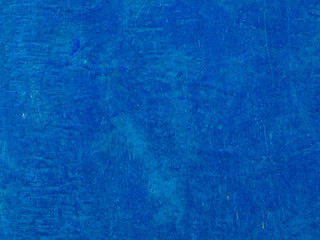 A blue wooden texture, with a cracked old paint. Background.