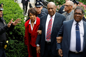 Actor and comedian Bill Cosby leaves with Sheila Frazier, John Atchison and publicist Andrew Wyatt after the third day of Cosby's sexual assault trial at the Montgomery County Courthouse in Norristown