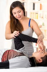 Sports massage. Massage therapist massaging shoulders of a male athlete, working with Trapezius muscle