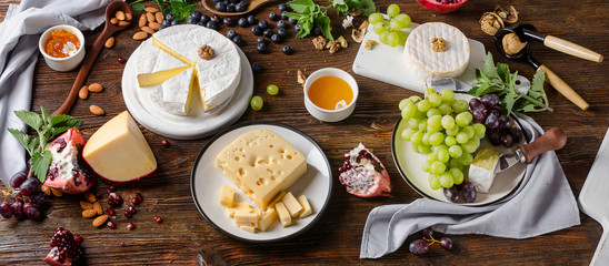 Cheese with grapes  on  wooden table
