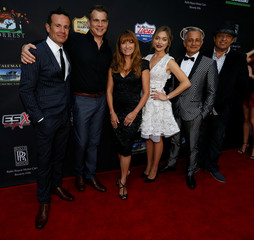 """Director Ranarivelo poses with cast members Ducey, Seymour, Stephenson, Afshar and Rodriguez at a premiere for the movie """"Pray for Rain"""" in Los Angeles"""