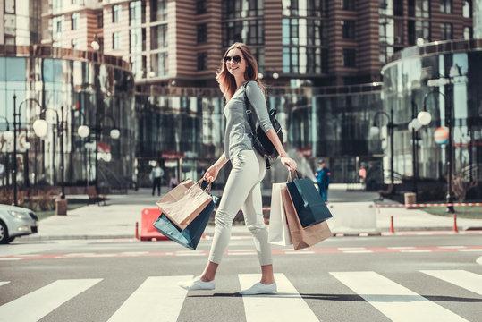 Girl doing shopping in city