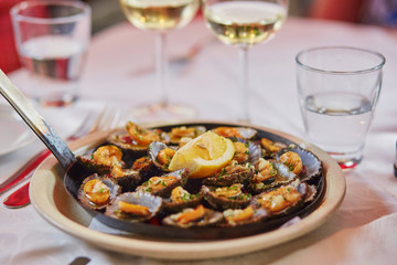 Grilled limpets served with lemon - traditional seafood on Madeira island, Portugal