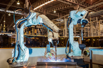 Industrail robot are test run new program in automotive  factory