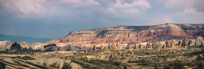 Colorful rose valley with dramatic sky in Cappadocia