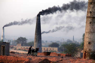 Smoke rises from the smoke stacks of brick factories on the outskirts of Islamabad