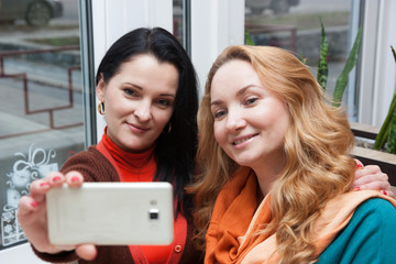 Happy woman in cafe and selfie