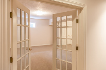 two french doors opening into empty room