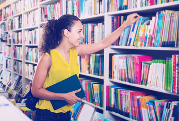 Young woman in book shop