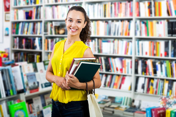 Woman taking literature books in store