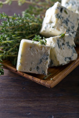Blue cheese on a wooden table .