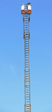 Basket with aerial platform over the very long special ladder of