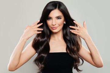 Healthy Woman with Long Wavy Hair. Haircare Concept