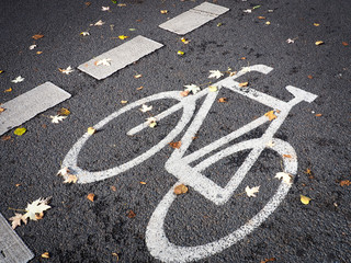 Bicycle symbol in street, bike lane