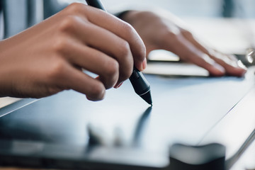 Cropped shot of businesswoman using graphic tablet with blank screen