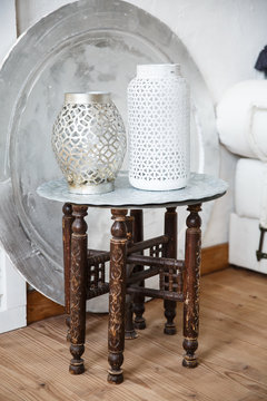 Vintage traditional arabic table with vases on it