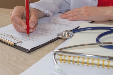 Doctor working in hospital writing a prescription. Medicine doctor's working table