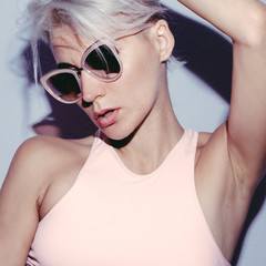 Blonde in fashionable sunglasses. Summer trend