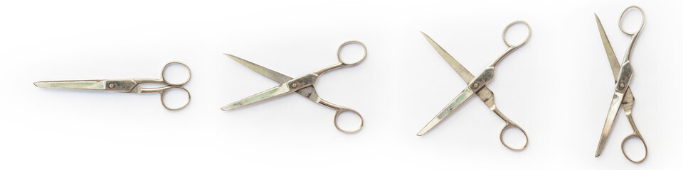 Open and closed scissors on white background.