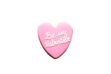 Gingerbread cookie with pink icing and be my Valentine inscription isolated on white