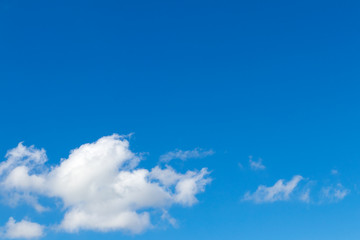 Blue sky with fluffy clouds.