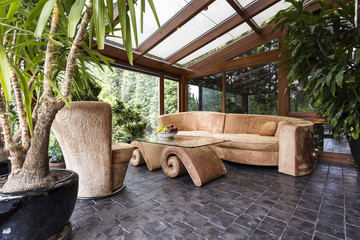 Stylish orangery with potted plants