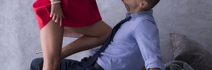 Woman putting her knee on her lover's chest