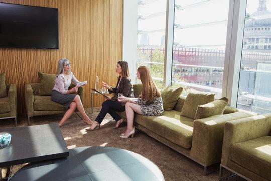 Businesswomen meeting on office sofa, London, UK