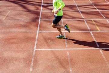 Senior man running on racetrack