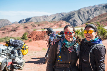 Portrait of two women  near touring motorbikes, Cafayate, Salta, Argentina, South America