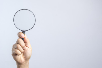Hand holding magnifier