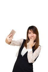 Young Asian woman making selfie photo on smartphone isolated on a white background, Clipping path