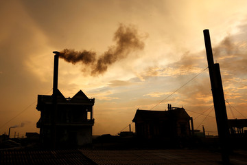Smoke rises from the chimney of a paper factory in Phong Khe village, outside Hanoi, Vietnam