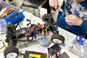 Repair radio controlled car for racing and master with screwdriver