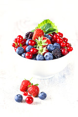 Freshly mixed berries in white bowl. Antioxidant concept.