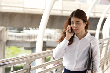 Business Woman is using phone