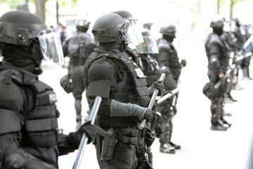 Police officers wearing riot gear.