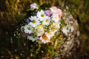 The bride's bouquet of beautiful natural flowers on the wedding day