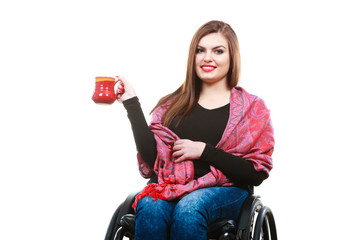 Cheerful crippled lady on wheelchair.