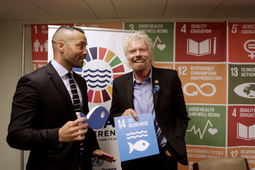 Sir Richard Branson poses for a picture with journalist Sherwin Bryce-Pease after delivering over 1 million signatures urging governments to protect 30 percent of the ocean by 2030 at the Ocean Conference at the United Nations in New York City