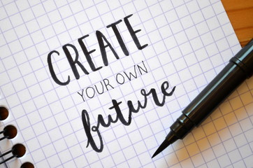 CREATE YOUR OWN FUTURE hand lettered in notebook