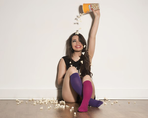 beauty girl in underwear playing with popcorn throwing to her head